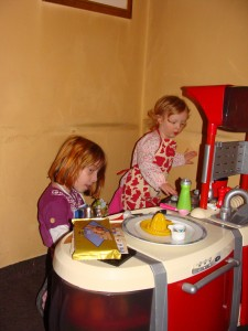 Lili and Annie playing with Lili's new skookum kitchen