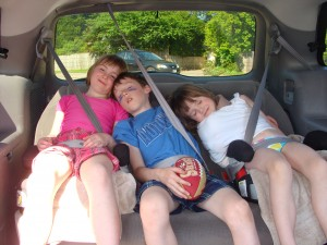 Evan, Emma and Amie pretending to be asleep. Poor Amie has a broken elbow.
