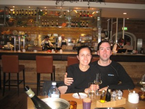 Ryan and Renata in front of the open kitchen.